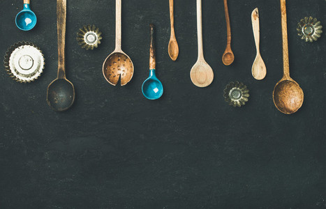 Flat lay of old vintage kitchen spoons and baking tin molds