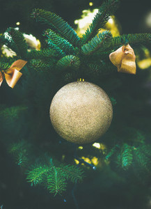 Christmas decoration glittering ball on a fur tree