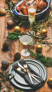 Holiday celebration table setting over rustic wooden background  selective focus