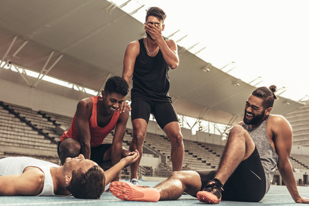 Group of athletes relaxing after workout