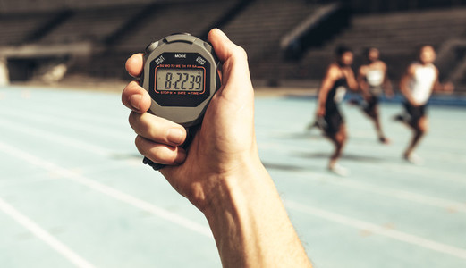 Man keeping time at a running race using stop watch