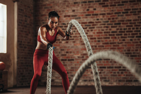 Battle rope workout at fitness studio