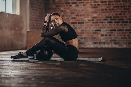 Woman relaxing after intense workout at gym