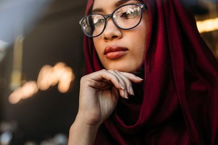 Thoughtful muslim woman looking away