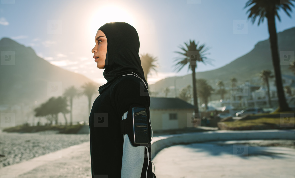 Muslim woman resting after a morning run