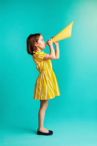 Girl speaking into paper megaphone