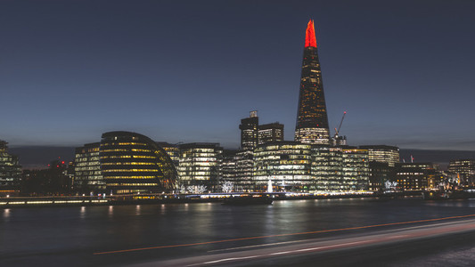 Modern London city skyline at night on River Thames shard buildi