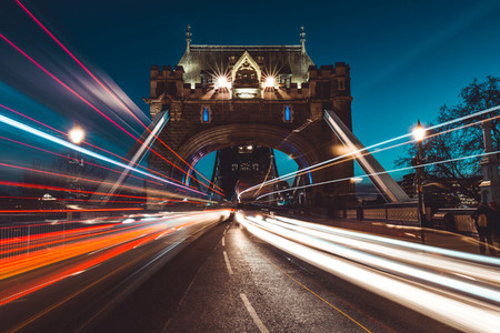 Traffic light trails on Tower Bridge London city skyline at nigh