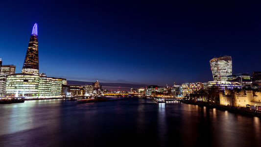 Panoramic view modern London city skyline River Thames night