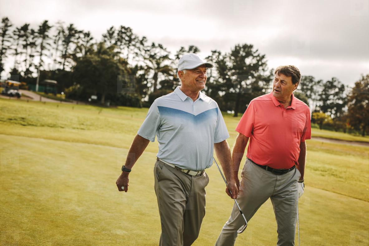 Senior golfers walking to the next hole