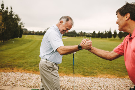 Senior golfers enjoying at golf driving range