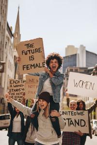 Women enjoying during a demonstration on road