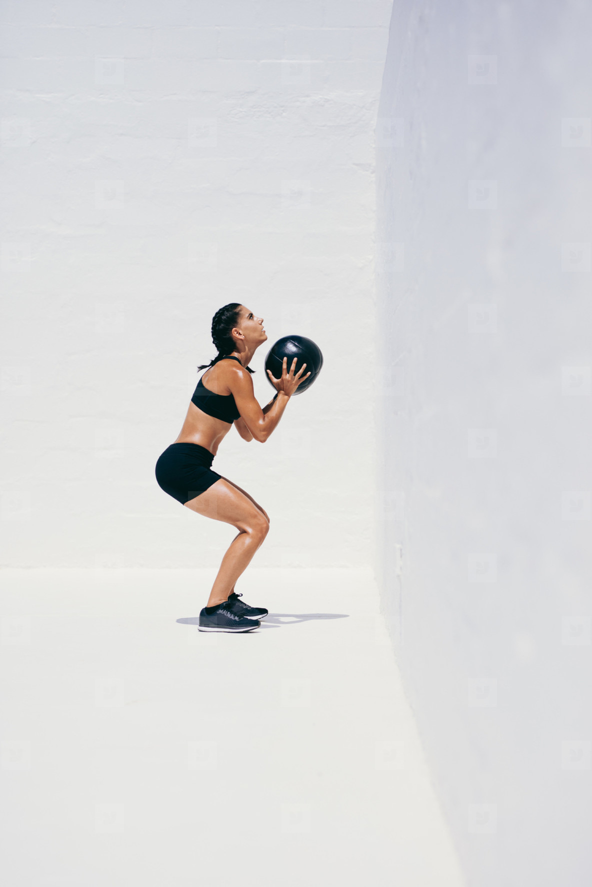 Fitness woman doing exercises using a medicine ball