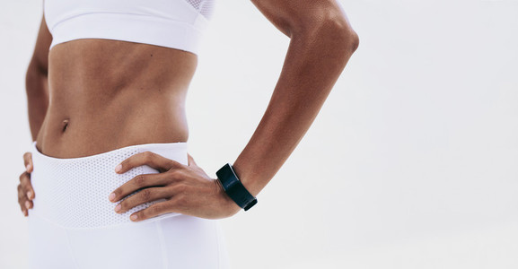 Close up of a fitness woman standing with hands on waist