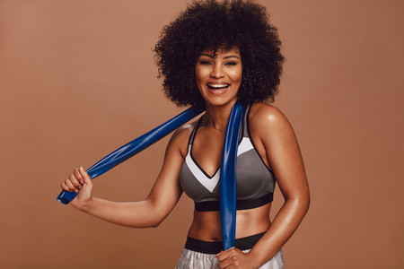 Sportswoman laughing with a resistance band
