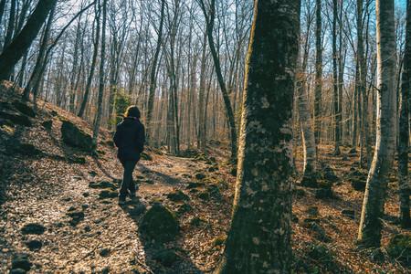 A girl walking through a forest