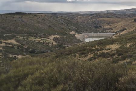 Antique dam in remote highlands in gloomy clouds