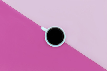 Minimal coffee cup top view bright pink color background