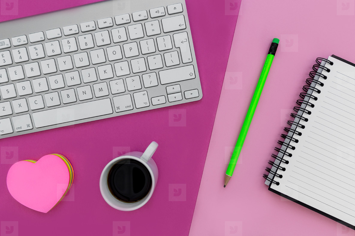 Minimal office workspace computer keyboard bright pink color bac