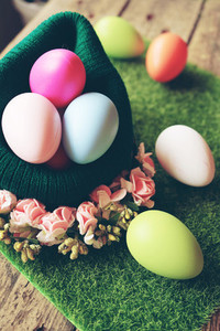A beautiful and colorful close up of easter eggs in a wool baske