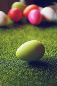 A beautiful and colorful close up of green easter egg over green