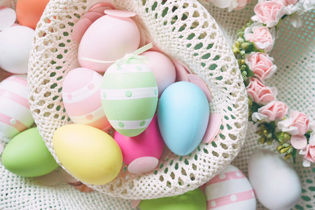 A beautiful and colorful close up flat of easter eggs in plain c