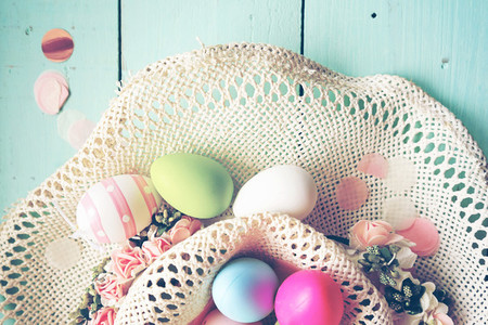 A beautiful and colorful close up flat of easter eggs in plain p