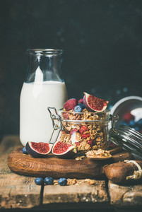 Oatmeal granola with bottled almond milk  honey  fruit and berries