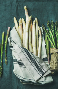 Fresh green and white asparagus in towel top view