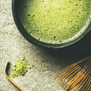 Flat lay of freshly brewed Japanese matcha green tea  square crop