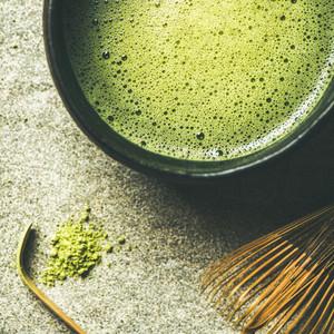 Flat lay of freshly brewed Japanese matcha green tea square crop