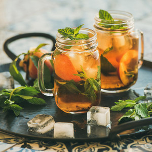 Summer refreshing cold peach ice tea  copy space