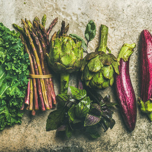 Flat lay of fresh green and purple vegetables  square crop