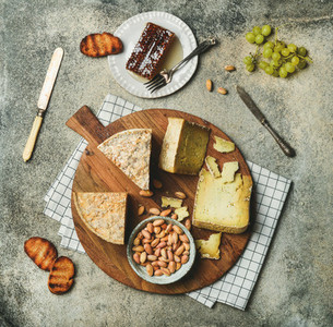 Flat lay of cheese platter with cheese assortment and snacks
