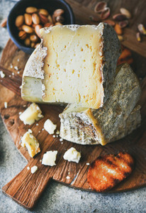 Cheese platter with nuts honey and bread close up