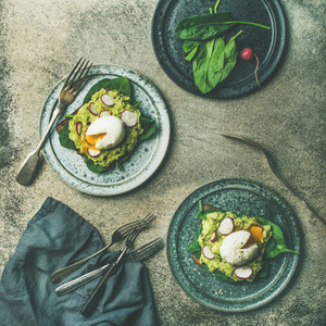 Healthy vegetarian wholegrain avocado toasts with poached egg  square crop