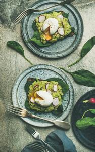 Healthy vegetarian gluten free breakfast flat lay Avocado and egg toasts