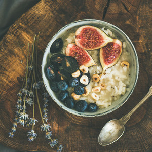 Rice coconut porridge with figs berries and hazelnuts square crop