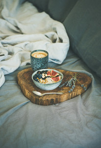 Rice coconut porridge and espresso in bed  copy space