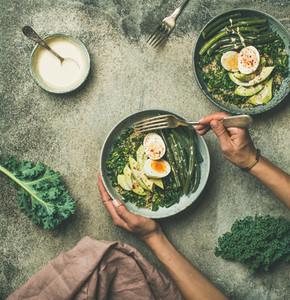 Quinoa kale beans avocado egg bowls flat lay top view