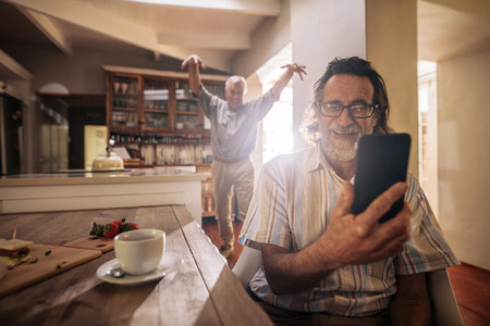 Elderly men having fun at home