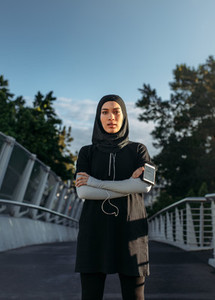 Confident Islamic woman in sportswear