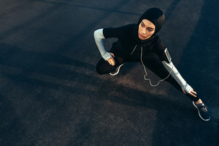 Islamic woman stretching after workout