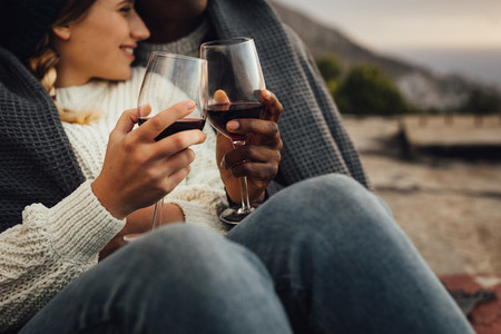 Loving couple with wine on a winter day picnic