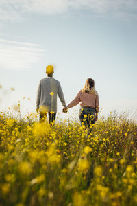 Loving couple in meadow admiring the view