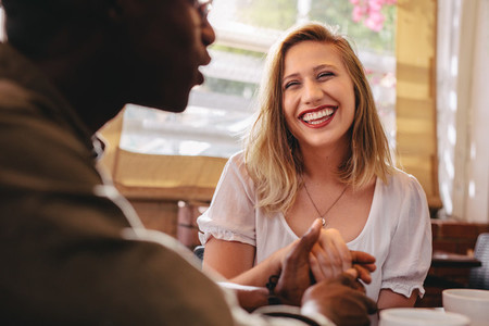 Interracial couple on date at cafe