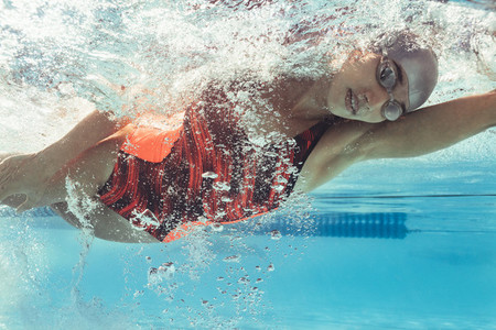 Young female swimmer in action
