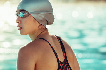 Professional swimmer looking away