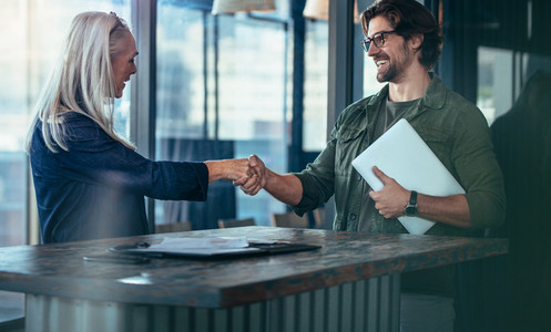 Business coworkers hand shake after meeting
