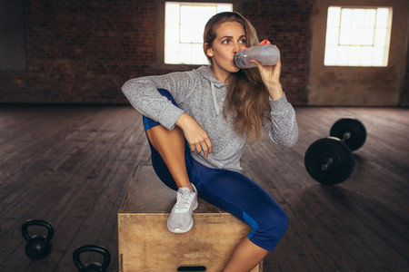Woman taking rest after fitness training at gym